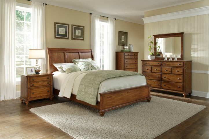 Hayden place oak sleigh bedroom set 4645 270 271 450 for Places to get bedroom sets