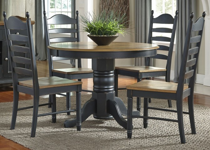 Springfield II Honey and Black Extendable Pedestal Dining Room Set