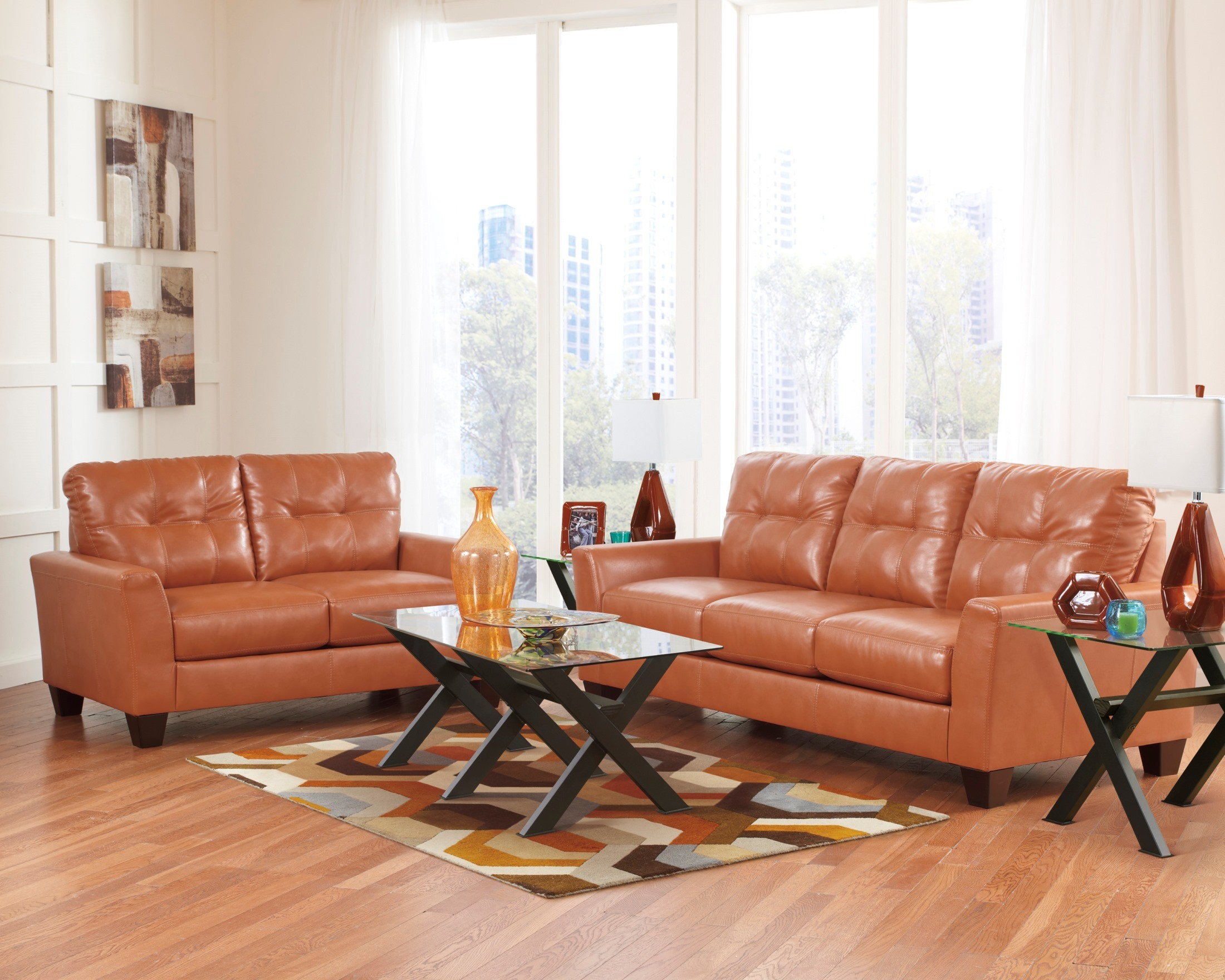 paulie durablend orange living room set from ashley 27002 38 35 coleman furniture