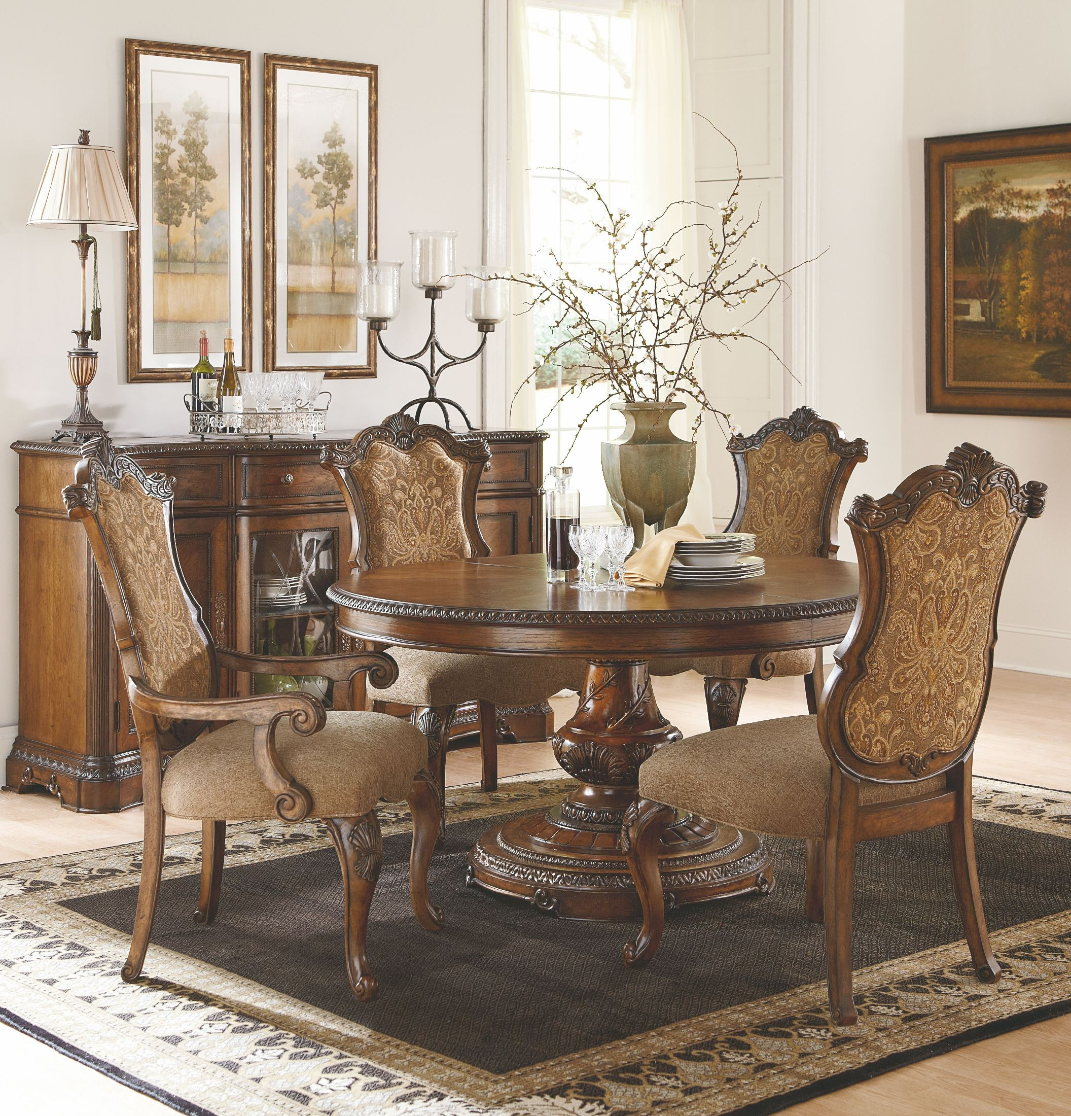 Pemberleigh extendable round to oval dining room set from for Classic dining room furniture