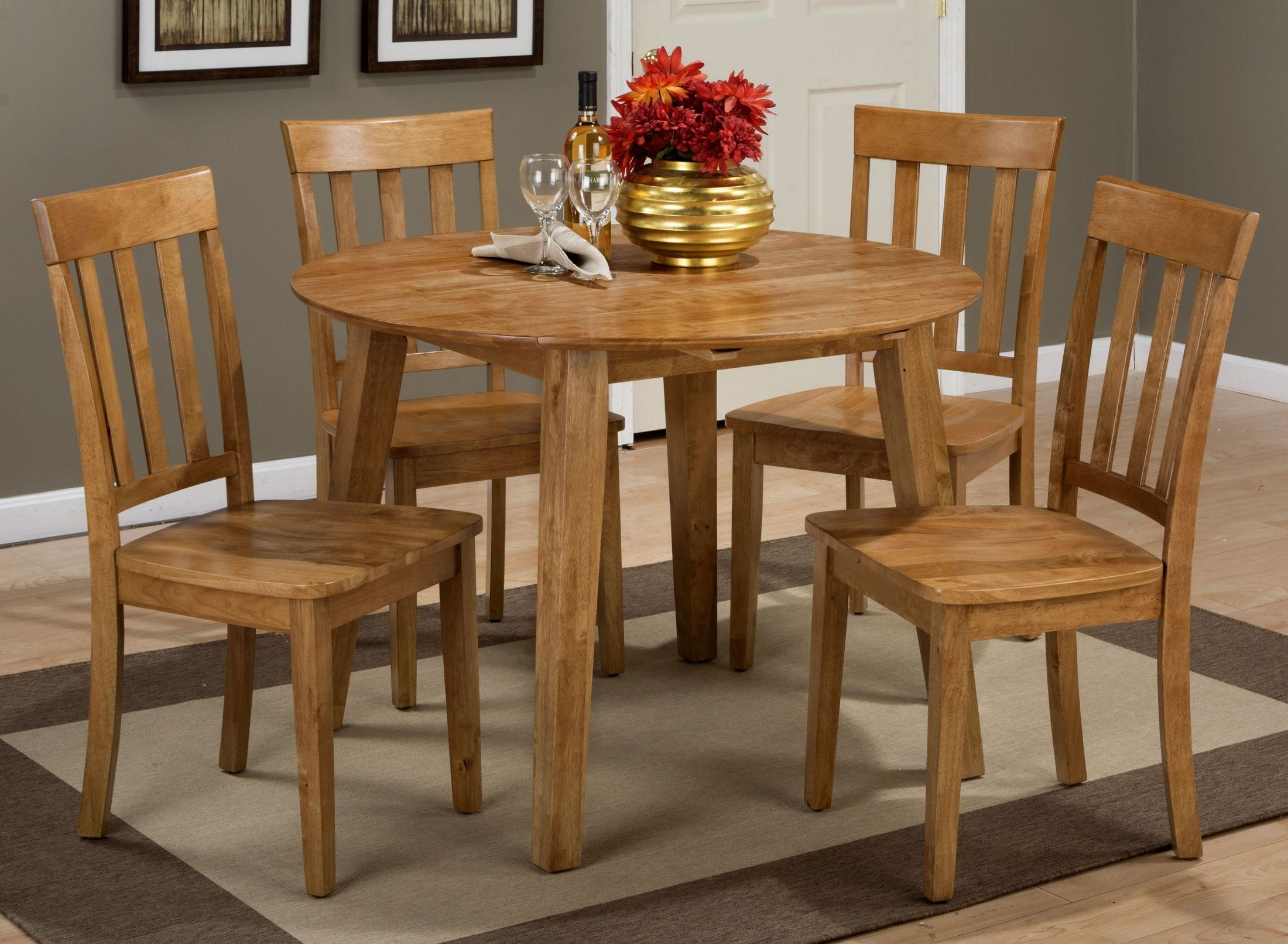 Simplicity honey extendable round drop leaf dining room for Round dining room table sets with leaf