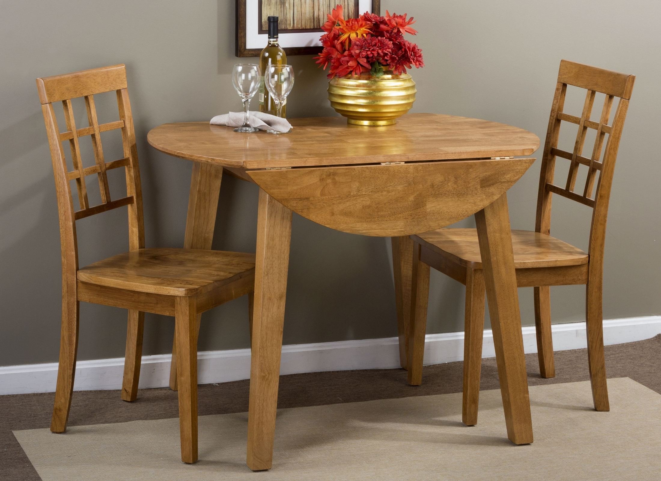 Simplicity honey extendable round drop leaf dining room for Round dining room sets with leaf