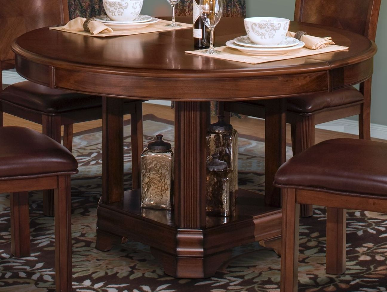 sheridan burnished cherry round dining table from new classics 40 005 18 18b coleman furniture. Black Bedroom Furniture Sets. Home Design Ideas