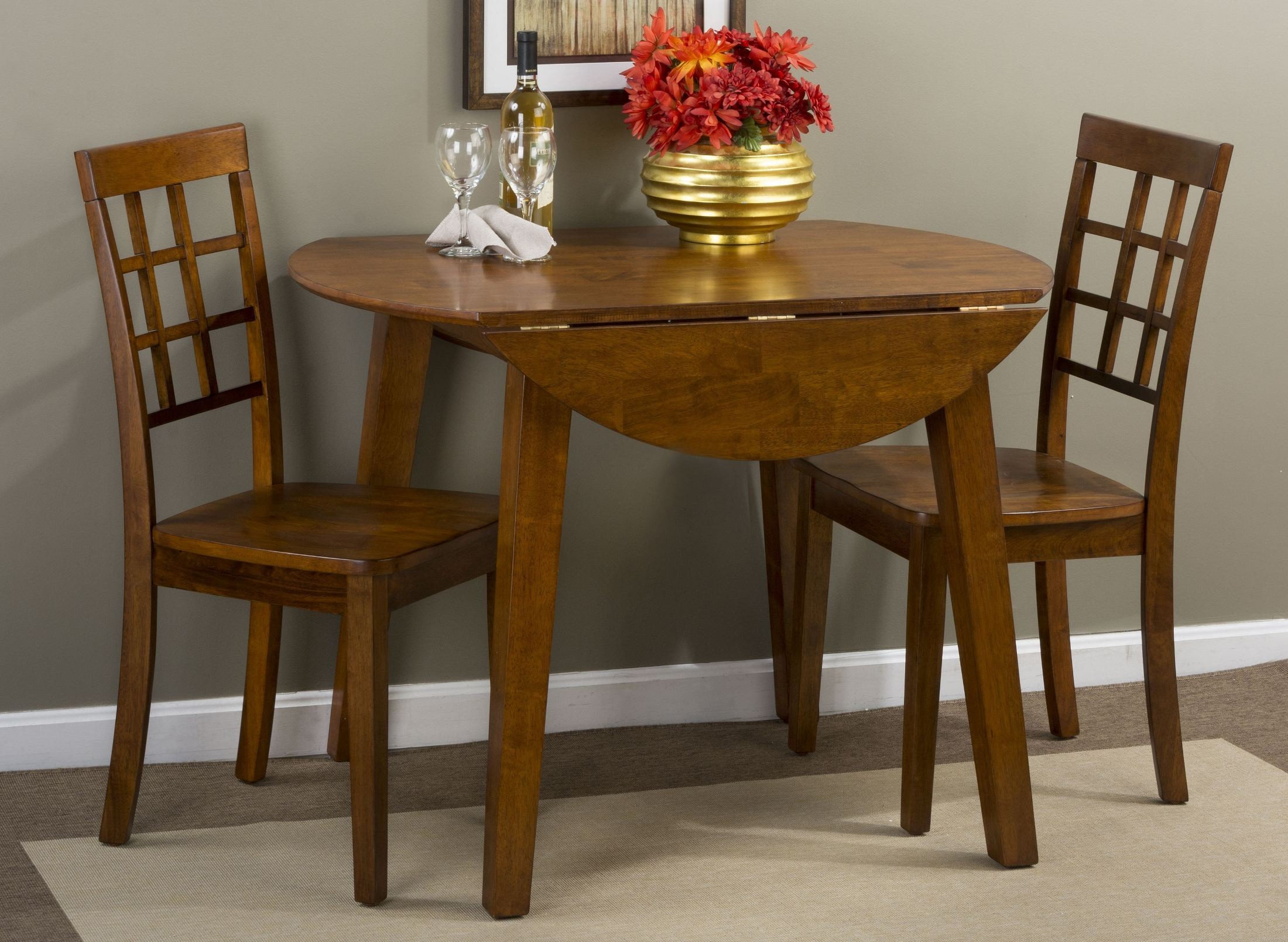 Simplicity caramel extendable round drop leaf dining room for Walter e smithe dining room sets