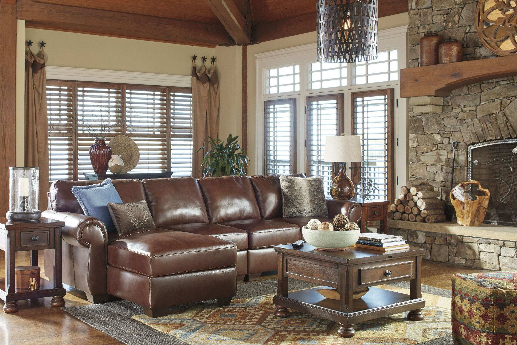 Lugoro saddle laf sectional 5060216 46 56 ashley for Affordable furniture 3 piece sectional in wyoming saddle