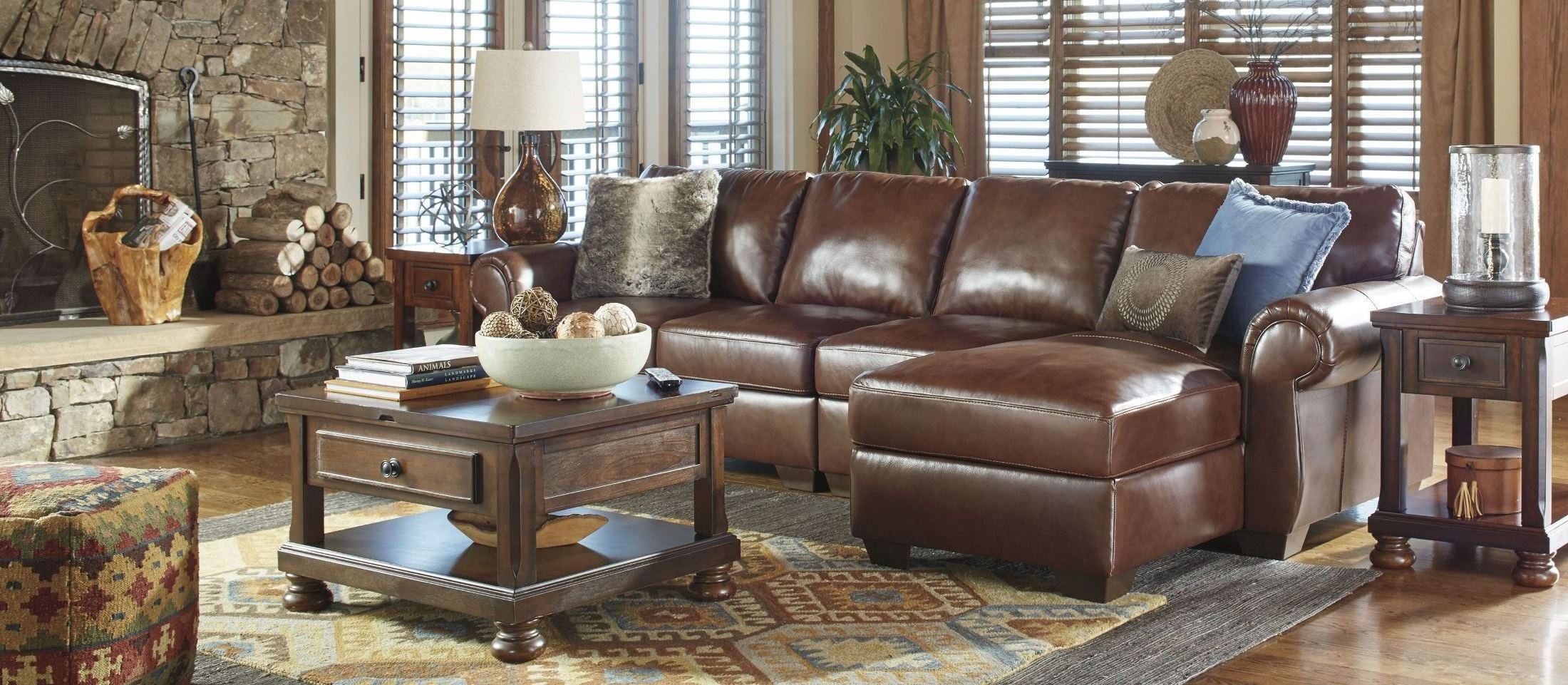 Lugoro saddle raf sectional 5060217 46 55 ashley for Affordable furniture 3 piece sectional in wyoming saddle
