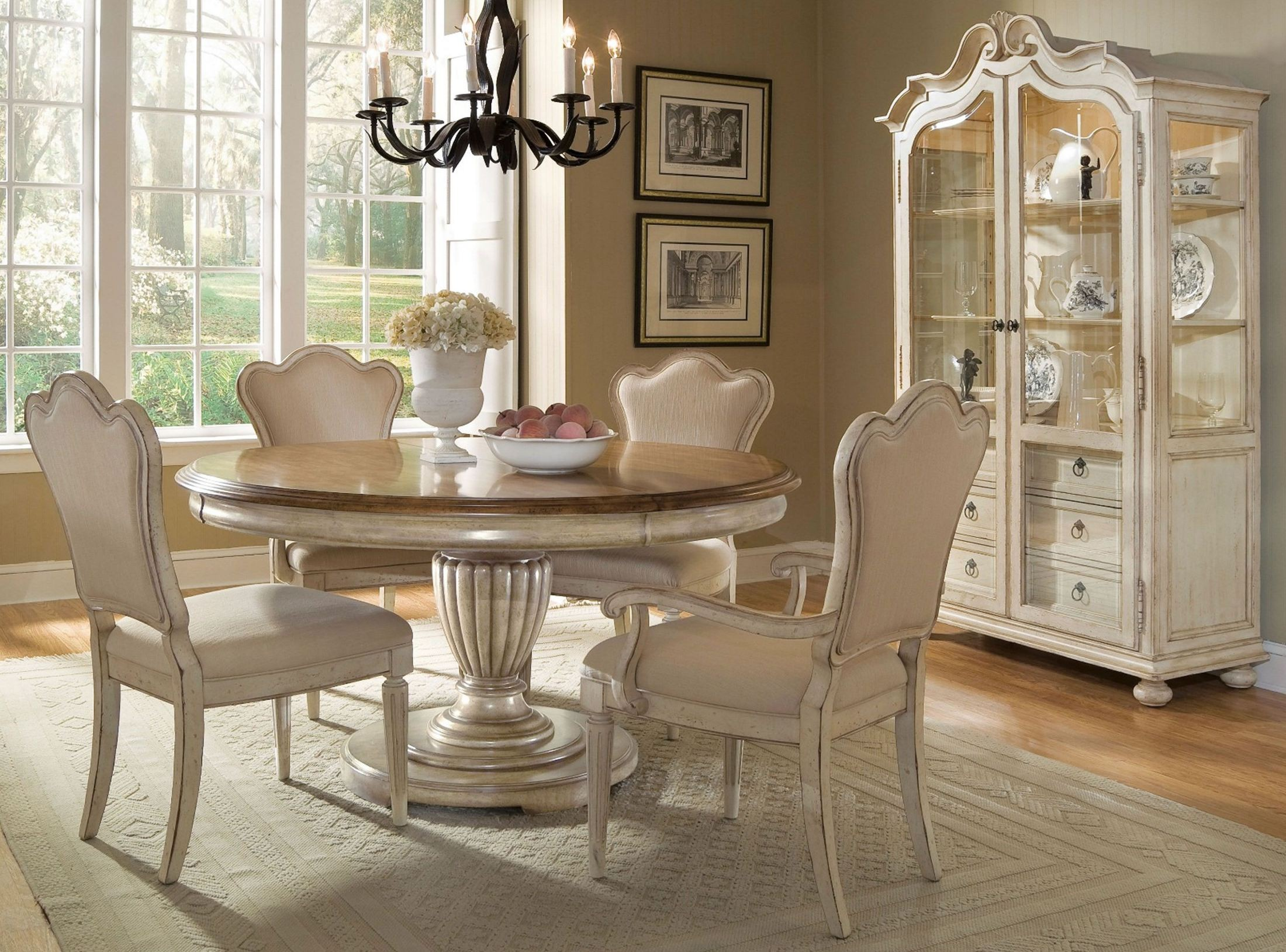 provenance round extendable dining room set from art