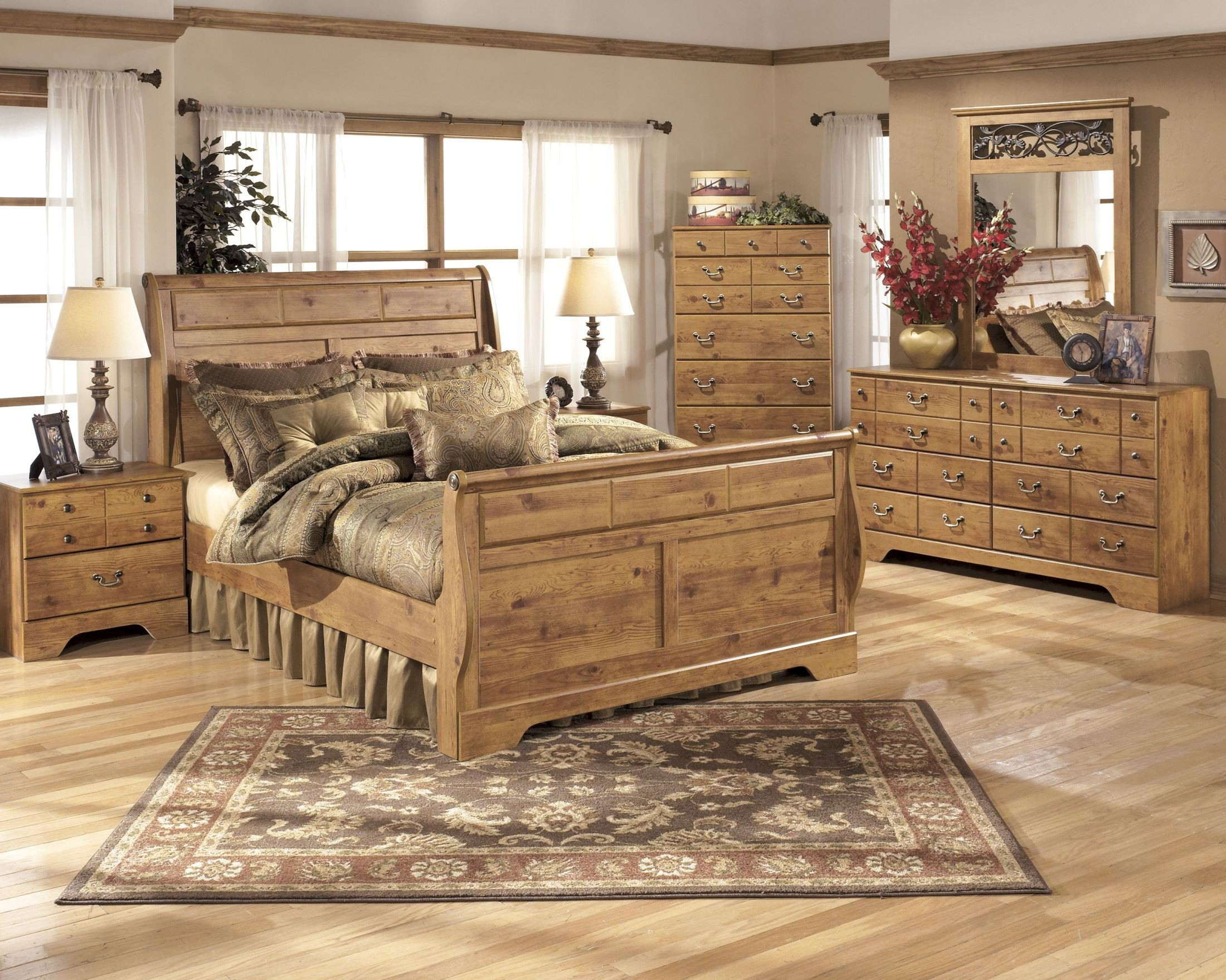 Bittersweet sleigh bedroom set from ashley b219 65 63 86 for Country style bedroom suites