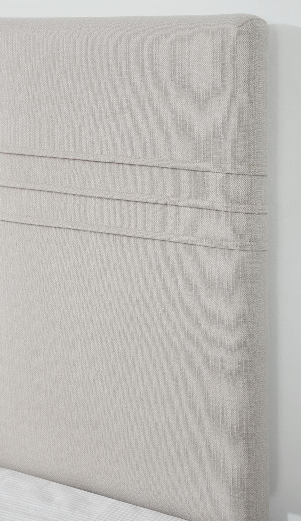 silver upholstered headboard