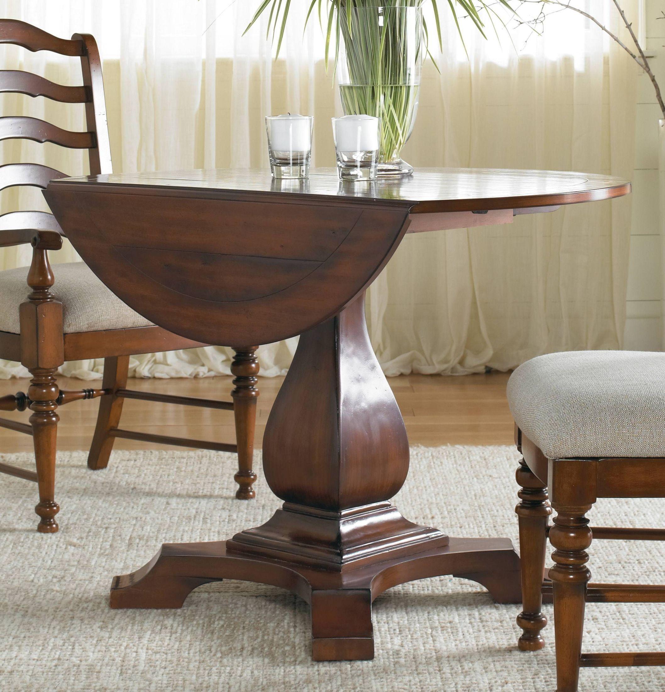 Waverly place cherry round drop leaf pedestal dining table for Round pedestal dining table set with leaf