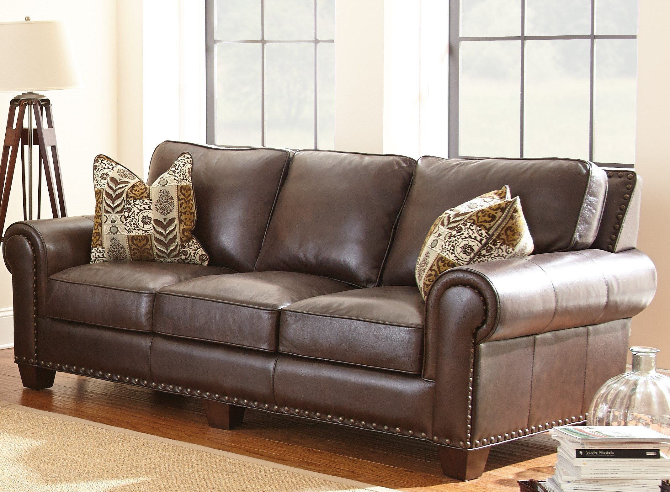 Escher top grain leather sofa with 2 accent pillows from for Cushions for leather sofas