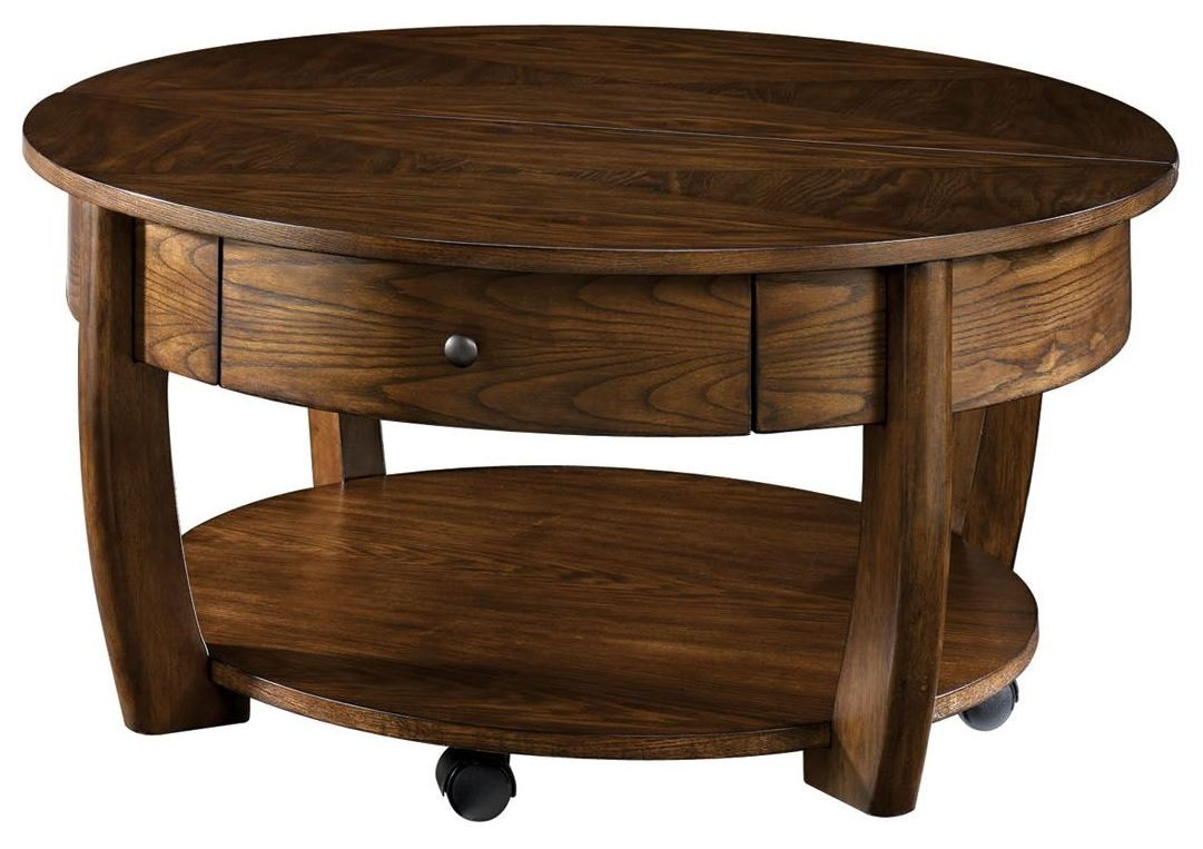 Concierge medium brown round cocktail table from hammary for Cocktail tables round