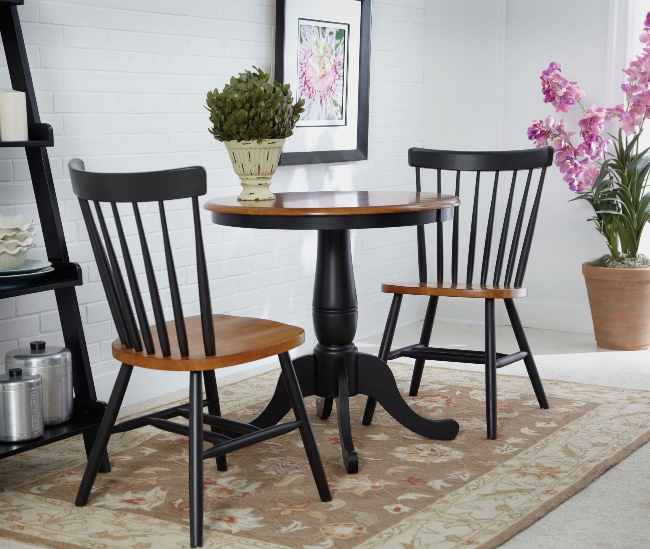 Black pedestal dining room table