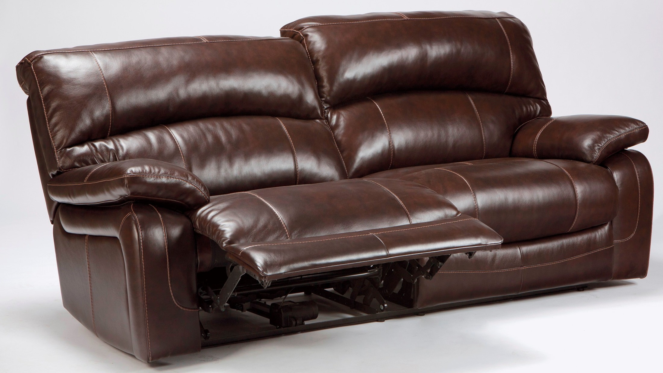 Damacio dark brown 2 seat power reclining sofa from ashley for Divan furniture
