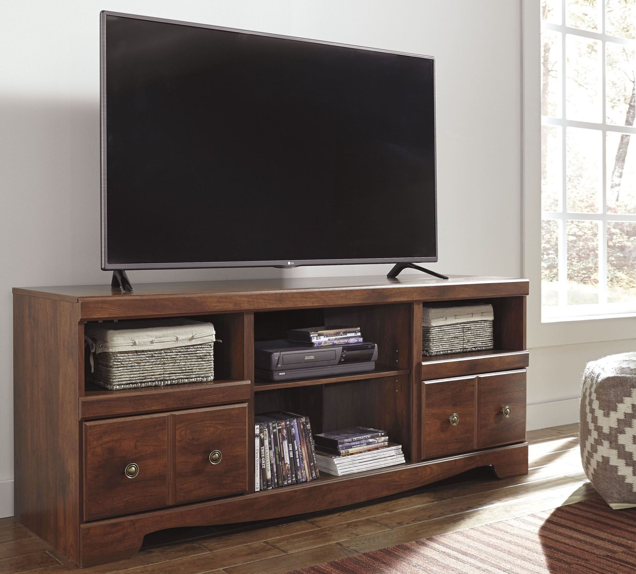 Brittberg Reddish Brown Entertainment Wall Unit from