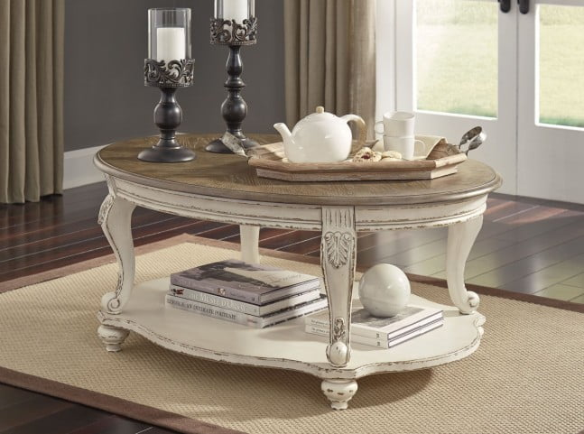Realyn White and Brown Oval Cocktail Table