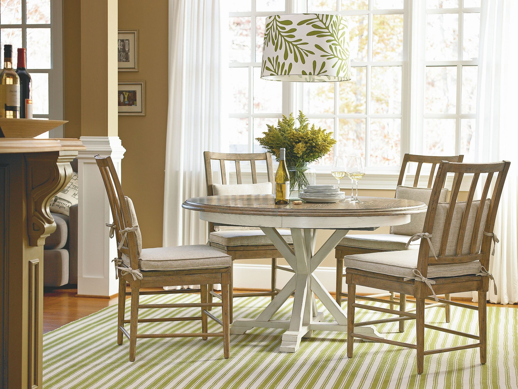 Great rooms brown garden breakfast round extendable dining for Brown dining room set