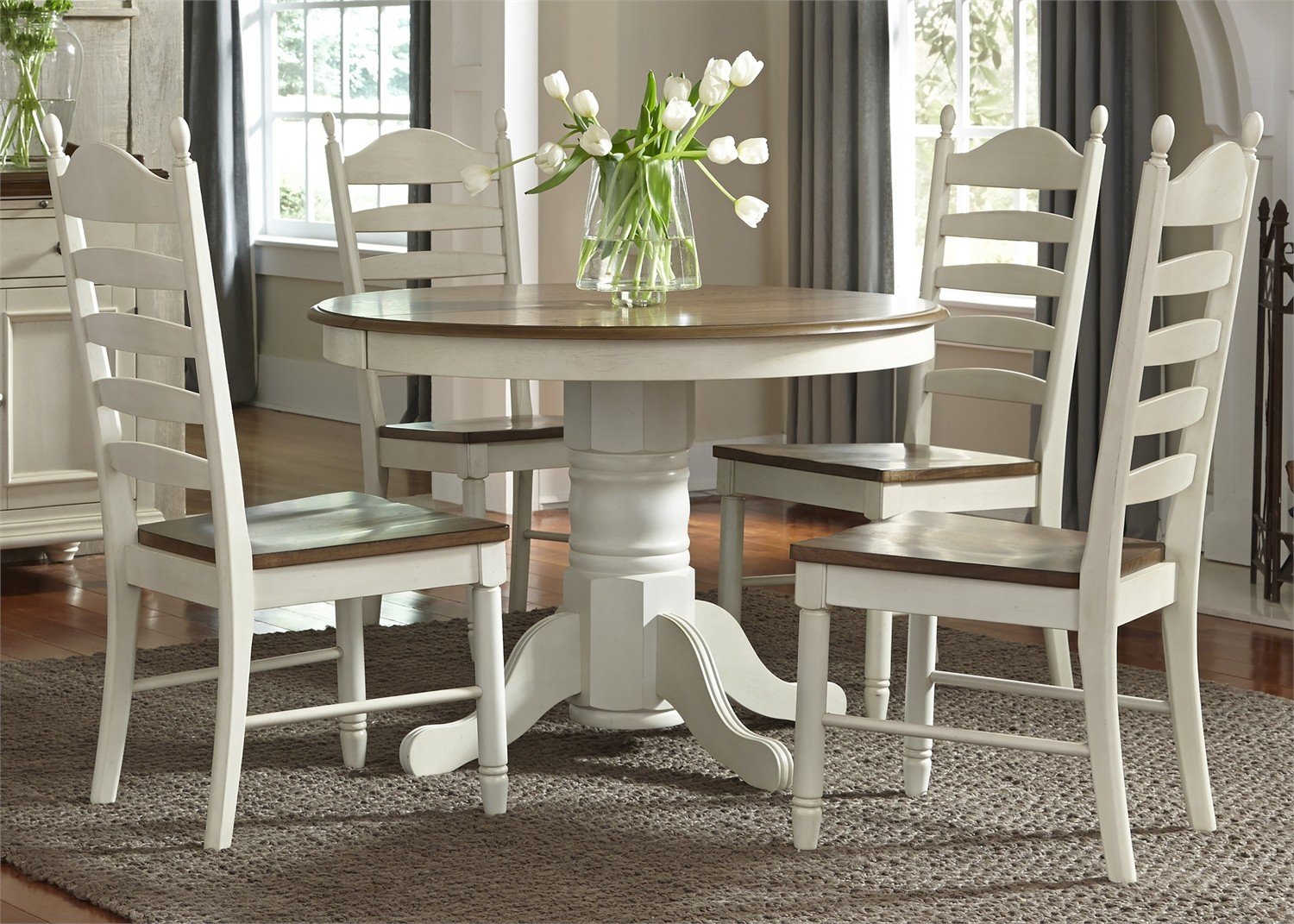 Springfield honey and cream extendable pedestal dining for Pedestal dining table and chairs