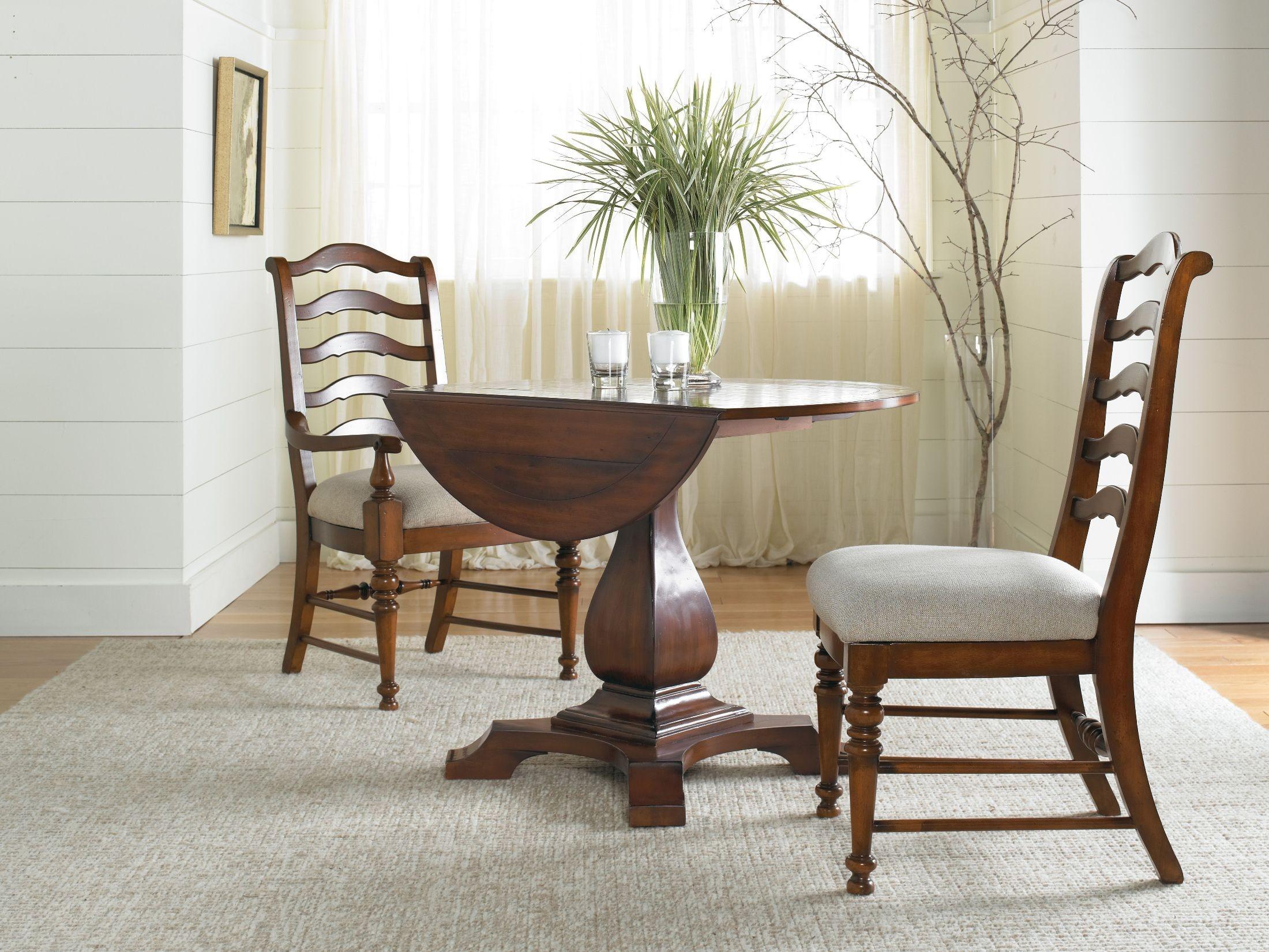 Waverly place cherry round pedestal dining room set from for Round pedestal dining table set with leaf