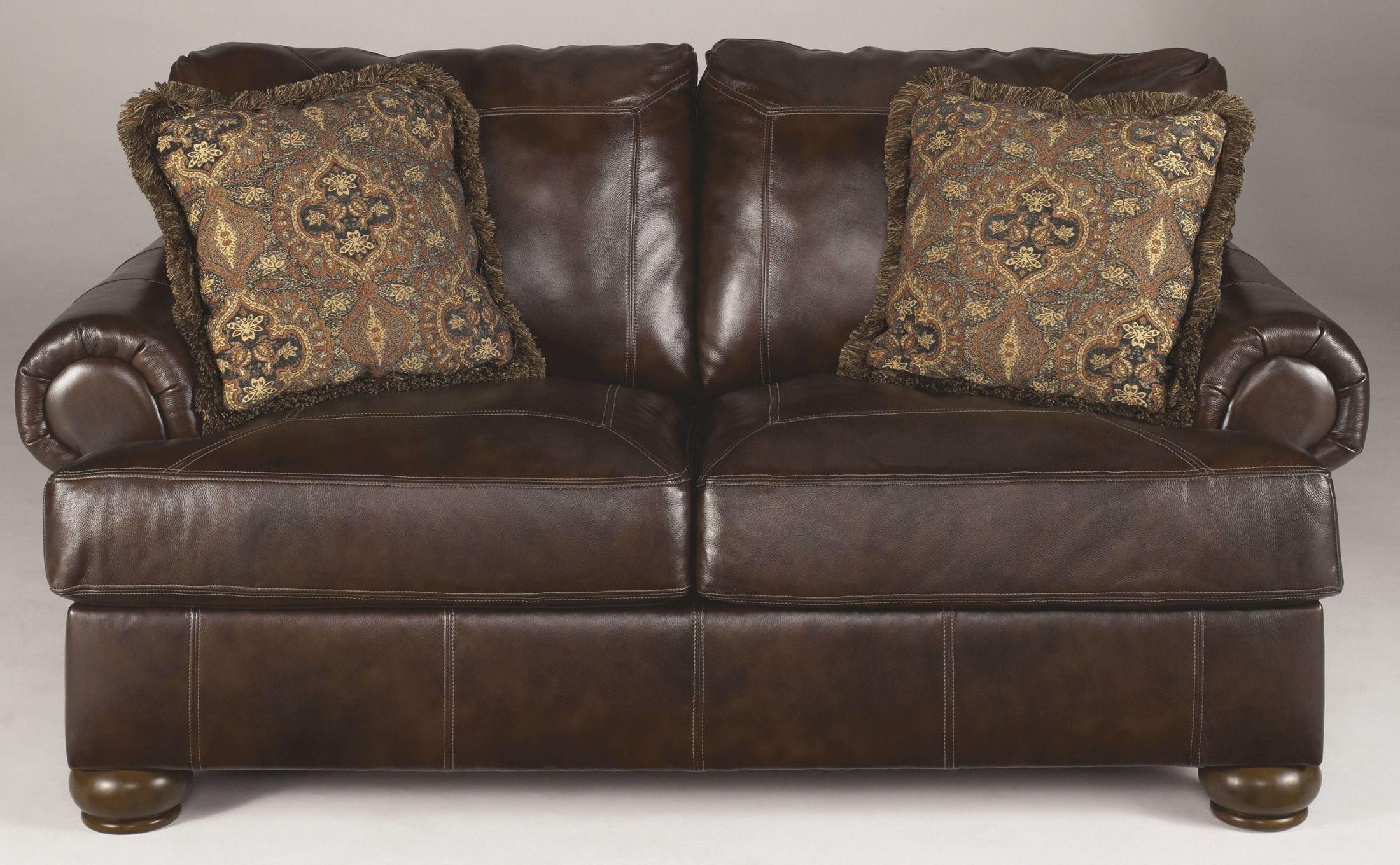 Axiom Walnut Living Room Set from Ashley