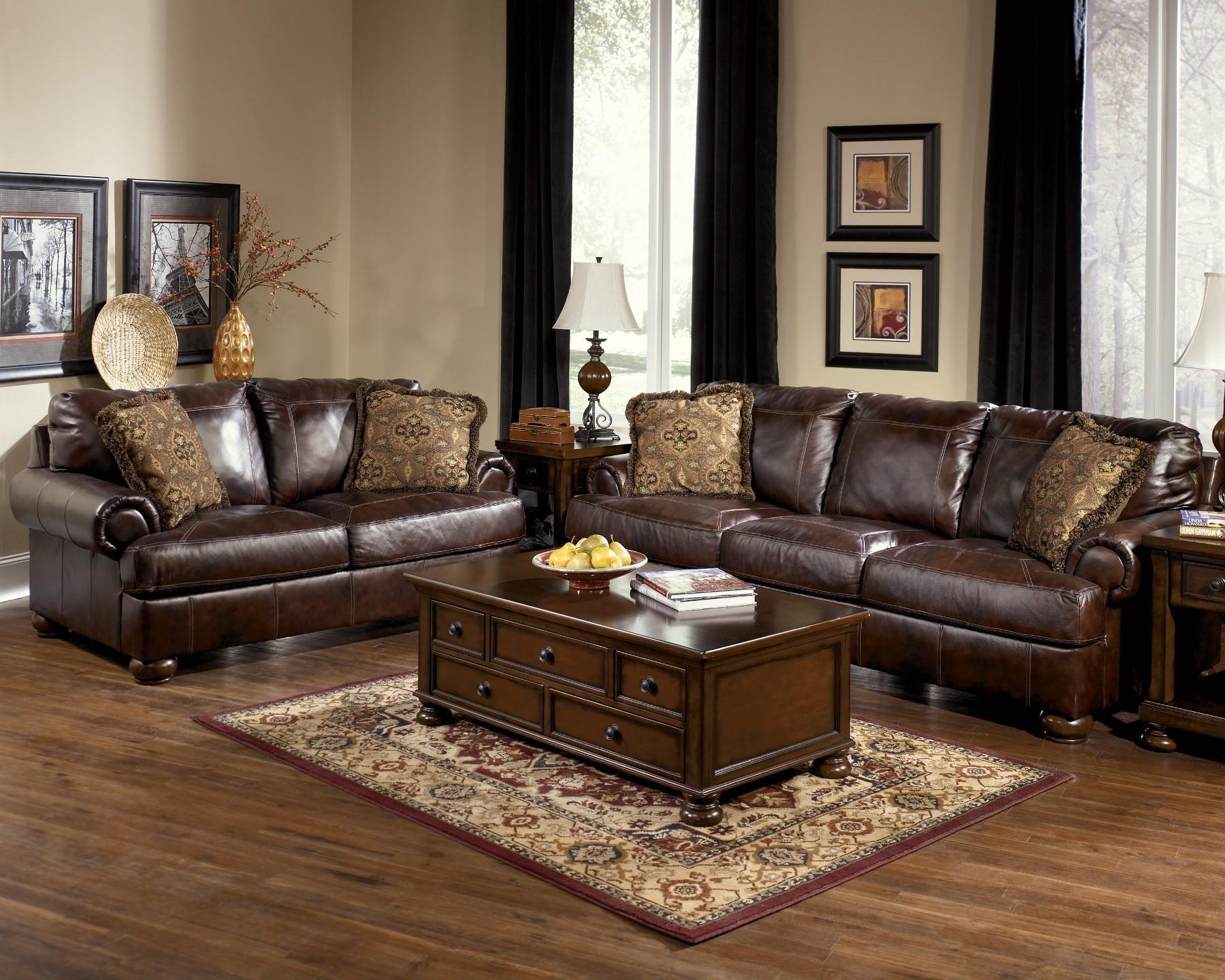 Axiom walnut living room set from ashley 42000 coleman furniture