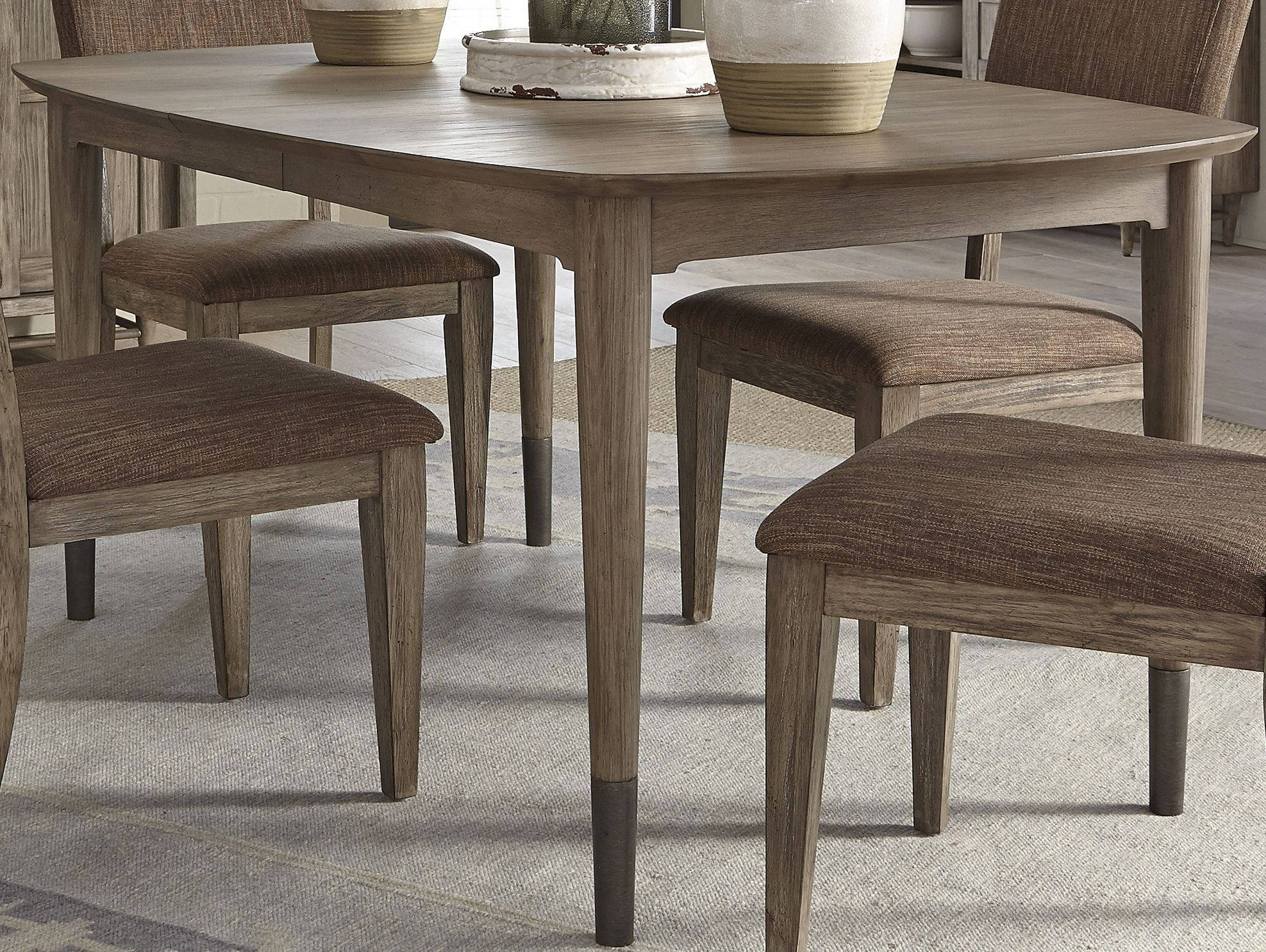 Miramar brown oval leg dining table from liberty coleman for One leg dining table