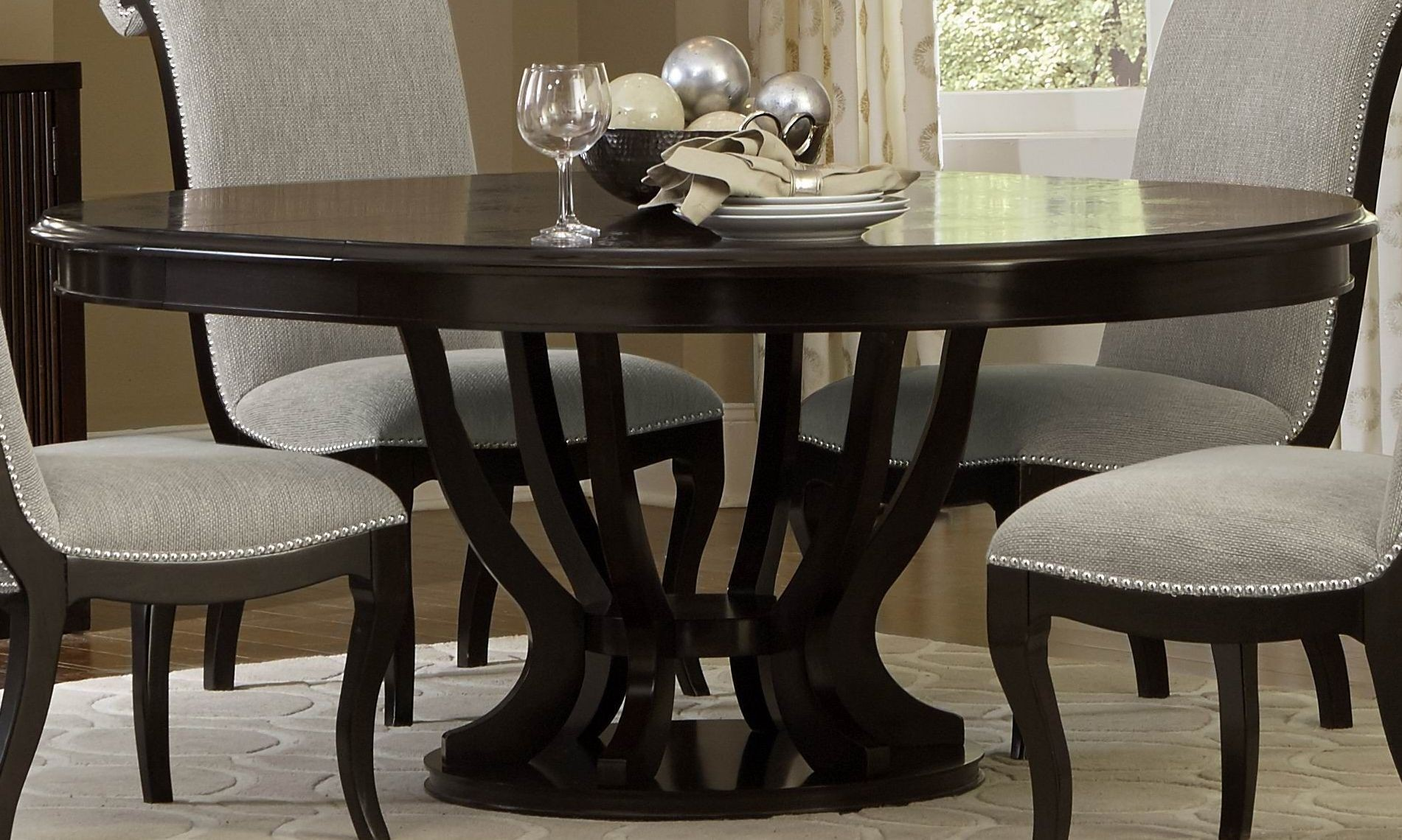 Savion espresso round pedestal extendable dining table for Round extendable dining table