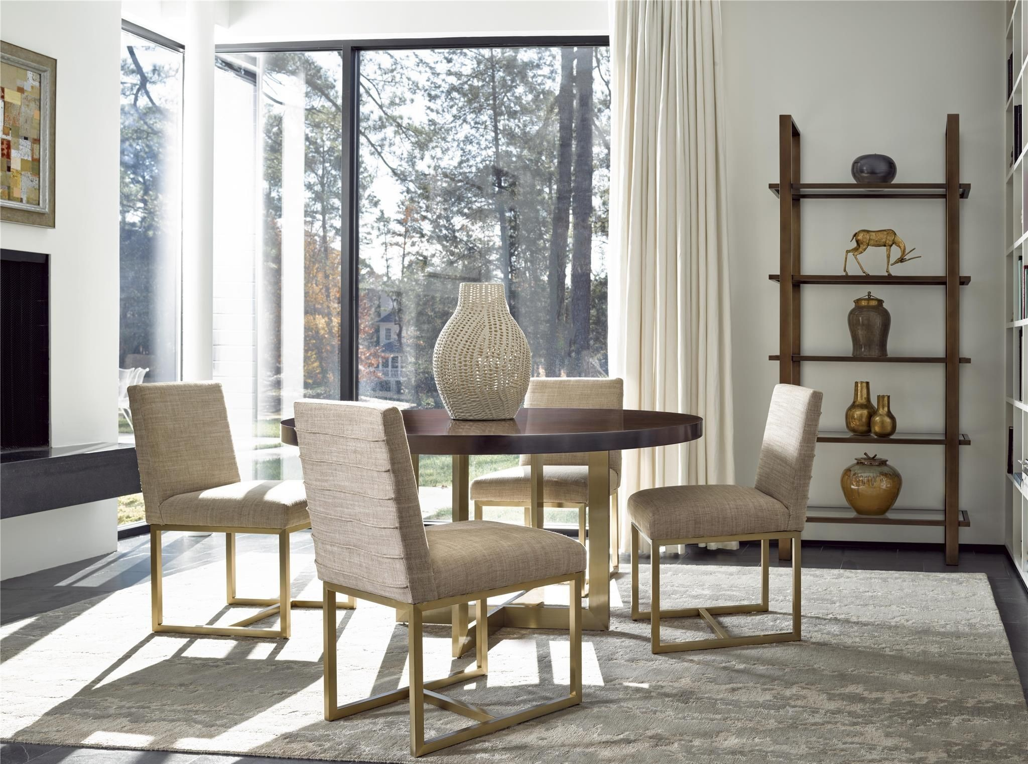 Gibson brown and gold round dining room set from universal for Brown dining room set