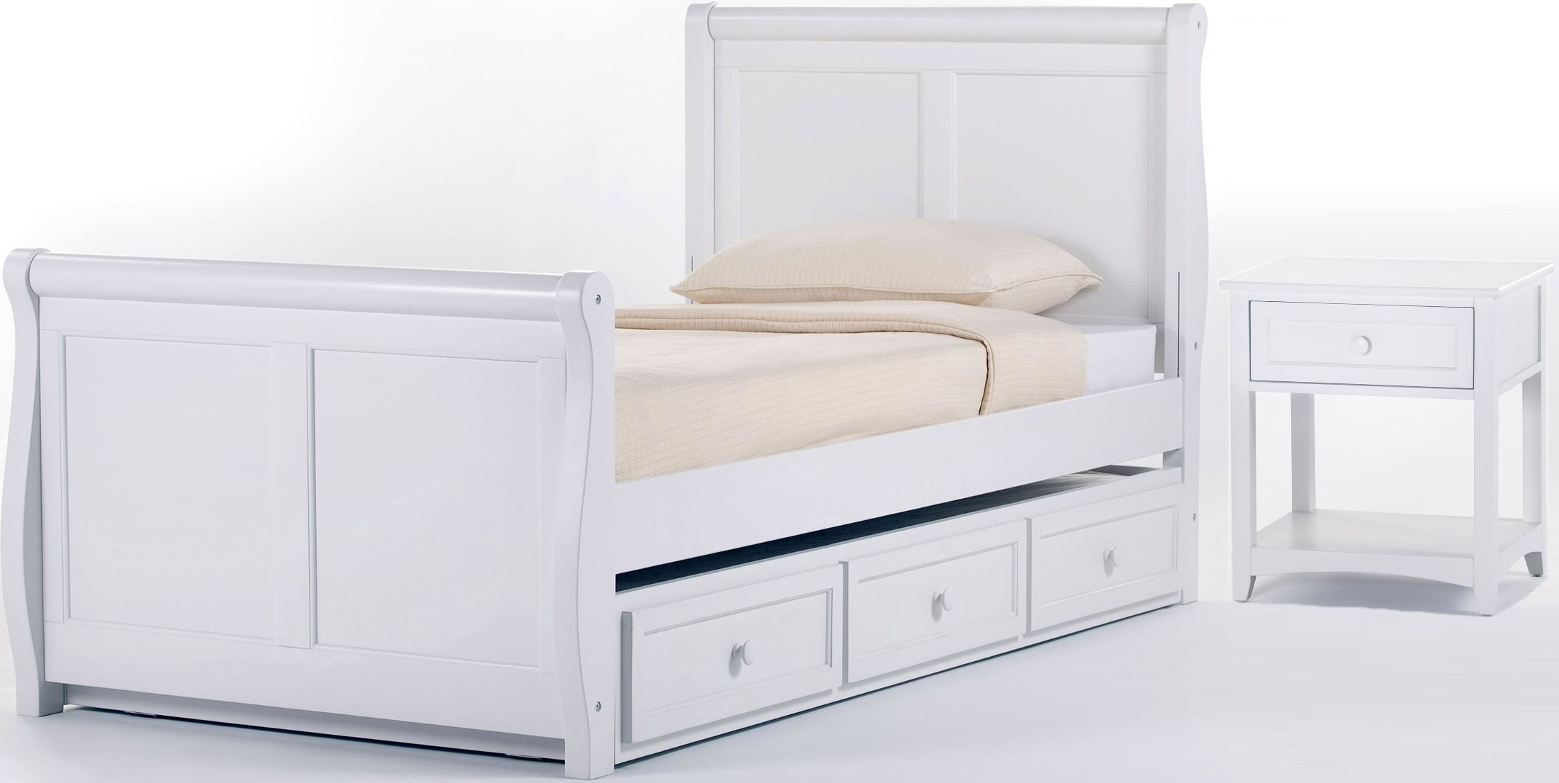 white sleigh bed with trundle