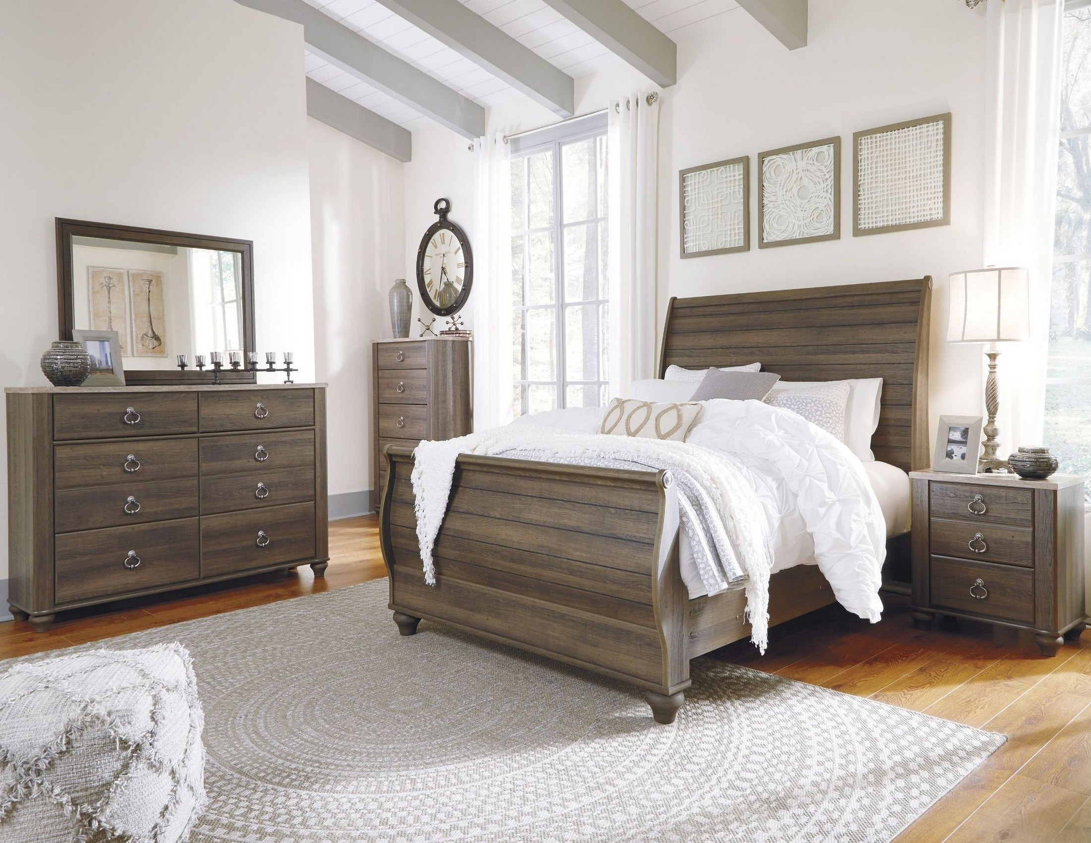 Birmington brown sleigh bedroom set from ashley coleman for Brown bedroom furniture