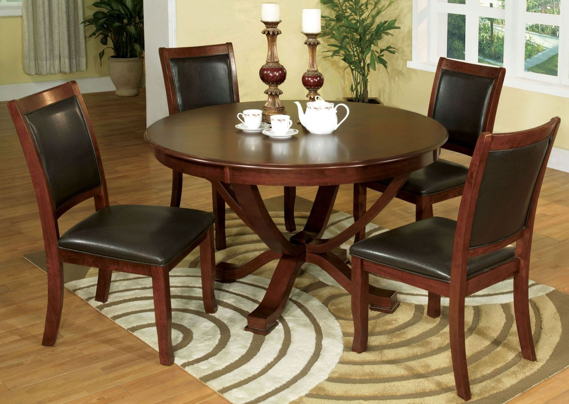 Sandy point brown cherry round pedestal dining room set for Brown dining room set