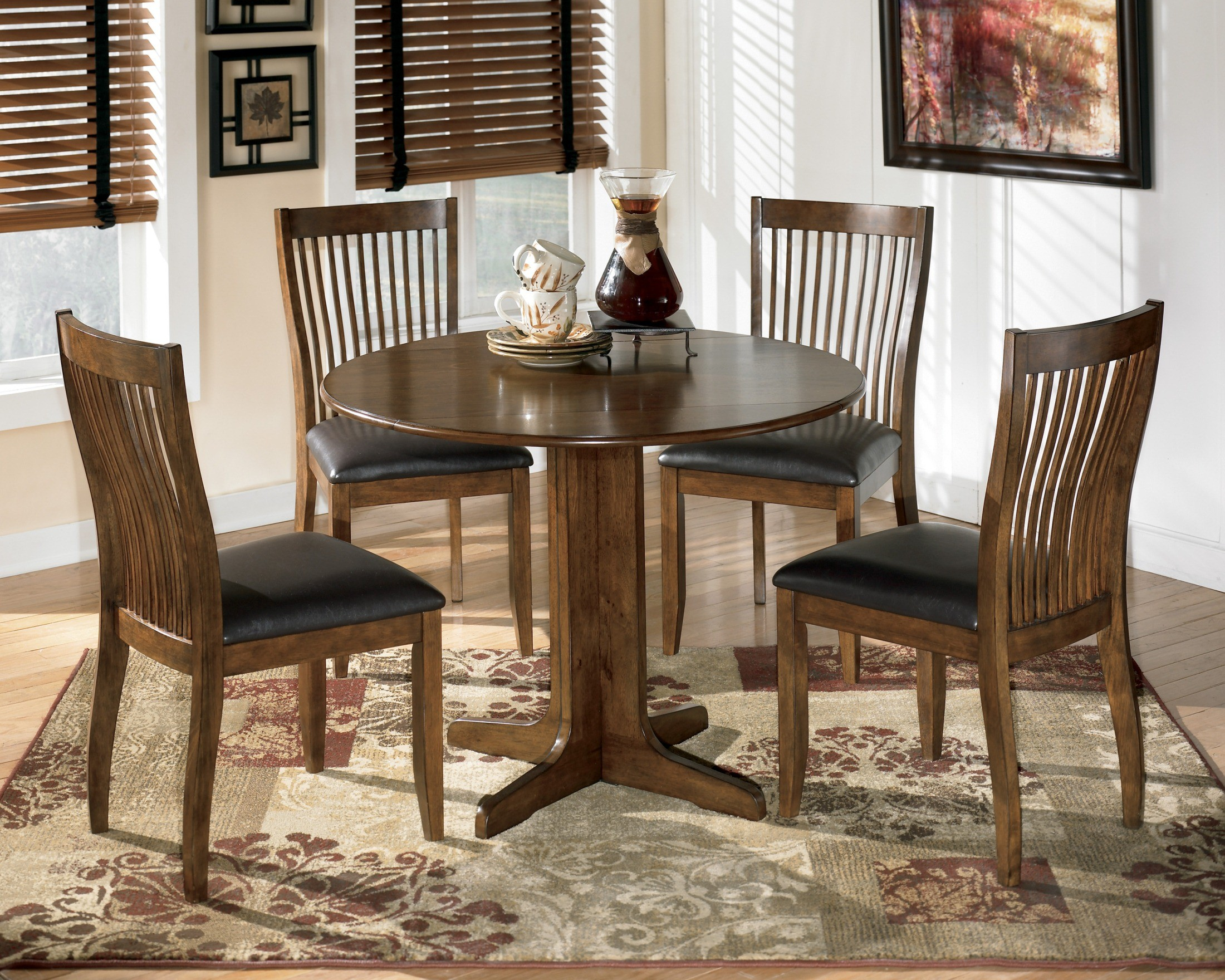 Stuman round drop leaf dining table set from ashley d293 for Round dining room sets with leaf