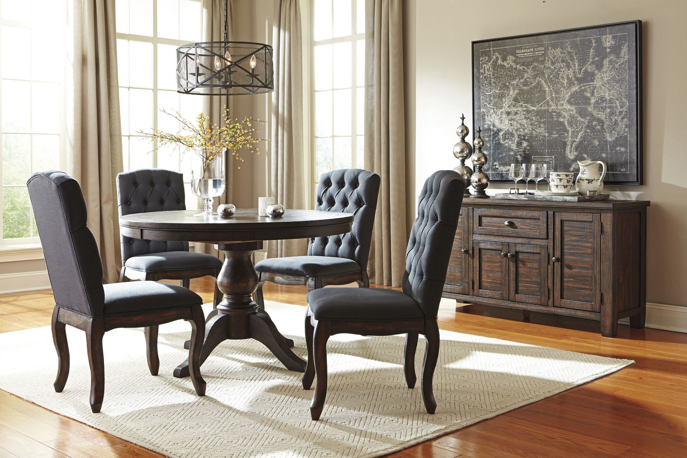 Trudell dark brown round extendable pedestal dining room for Brown dining room set