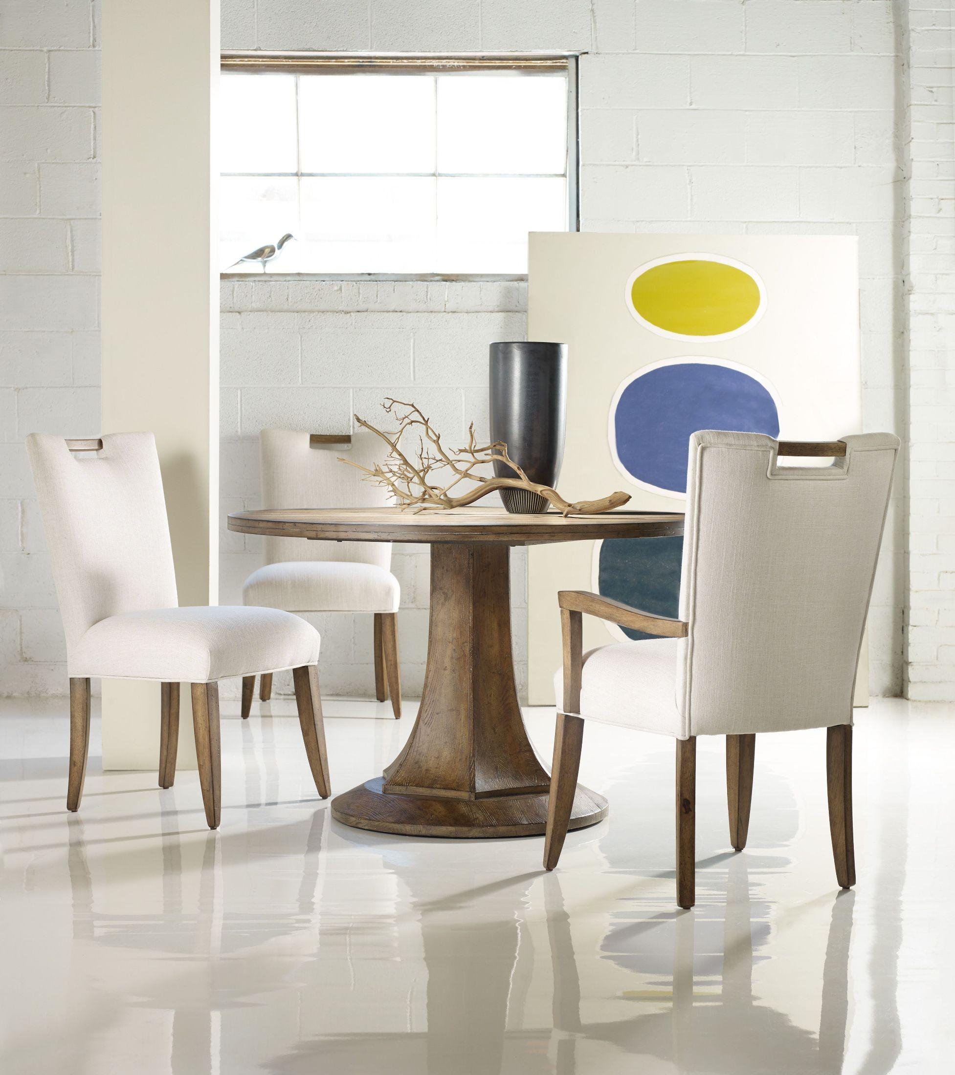 Melange brown barrett round dining room set from hooker for Brown dining room set