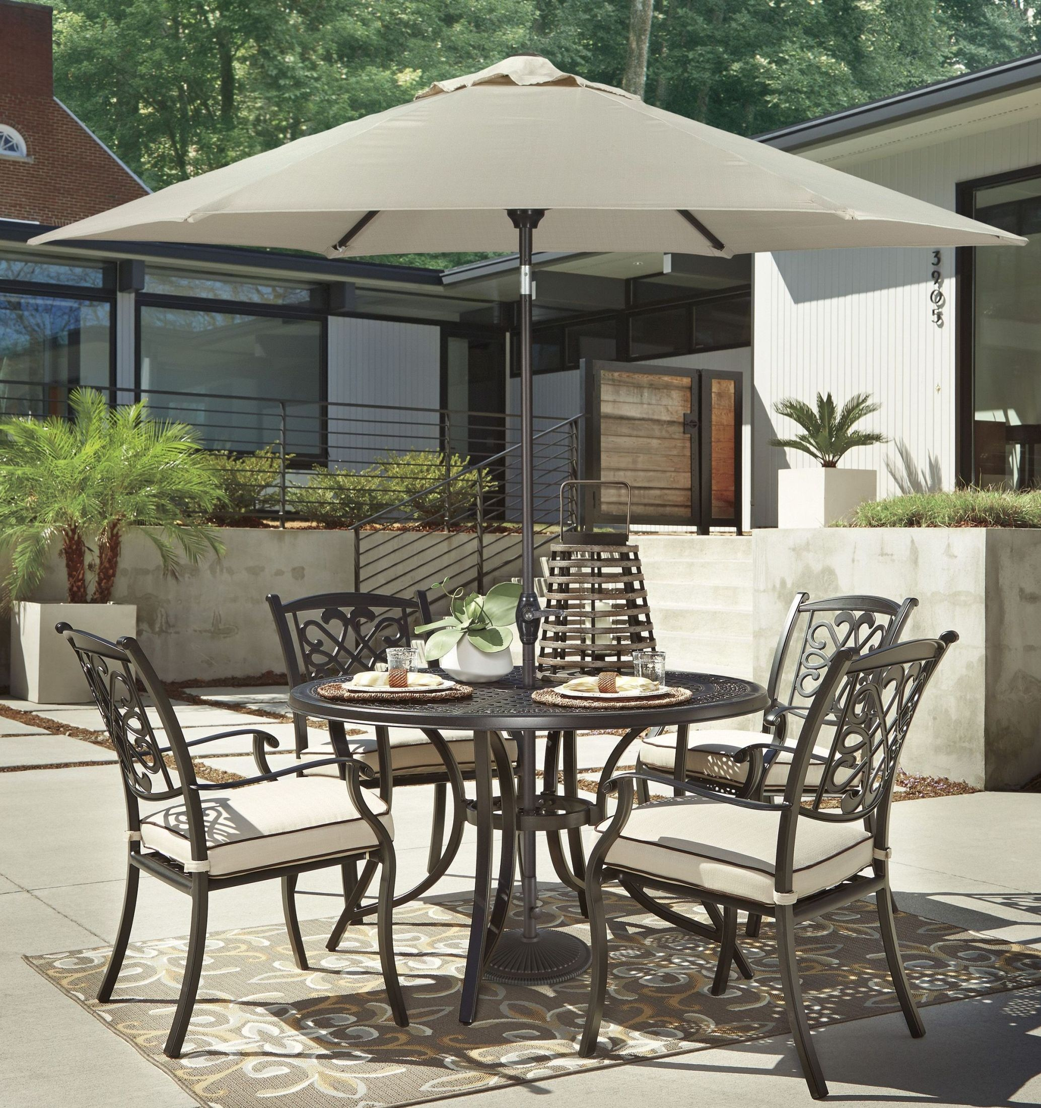 Burnella Beige and Brown Outdoor Round Dining Room Set from Ashley